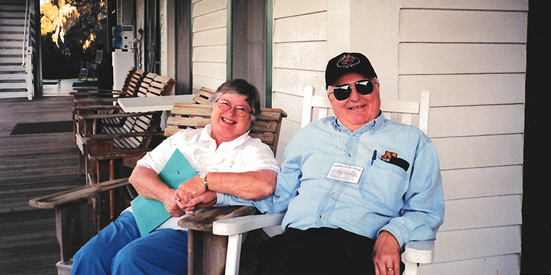 Bob and his wife sitting on their porch.
